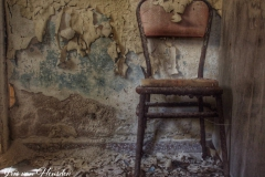 A Chair where the baker of an abandoned Greek bakery used to have lunch -1