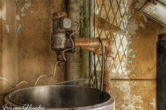 An antique dough mixer in an abandoned Greek bakery