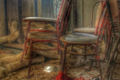 Chairs collecting dust in an abandoned Greek bakery-1