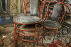 Chairs collecting dust in an abandoned Greek bakery-2